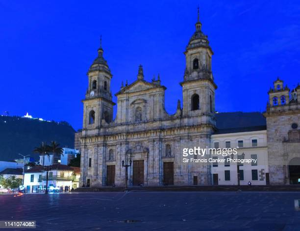 cathedral of bogotá illuminated at dusk on bolivar square (plaza bolivar) in bogota, colombia - cundinamarca stock pictures, royalty-free photos & images
