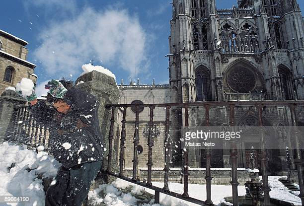 Cathedral of Burgos Burgos A boy plays with balls of snow next to the cathedral magnificent Gothic building built among the XII and XVI centuries