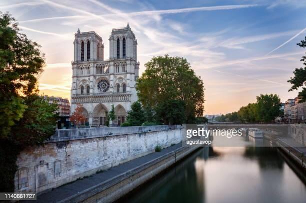 cathedral of notre dame front view at dramatic dawn – paris, france - notre dame de paris stock pictures, royalty-free photos & images