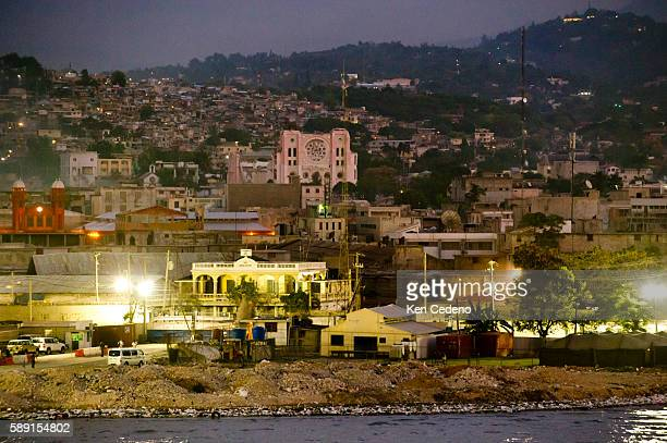 Cathedral of PortAuPrince is seen at dusk from the ocean with the Iron Market to the left April 9 2011 in PortAuPrince Haiti