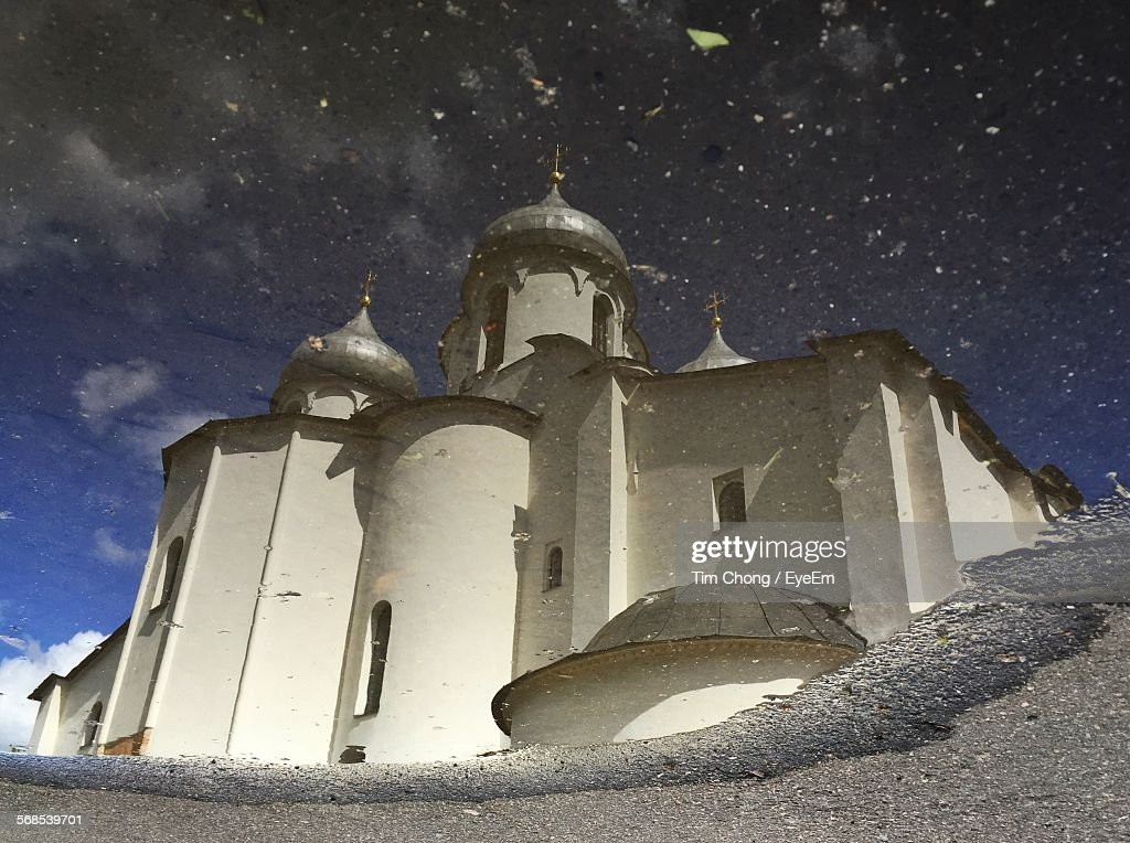 Cathedral Of Saint Sophia Reflected In Puddle : Stock Photo