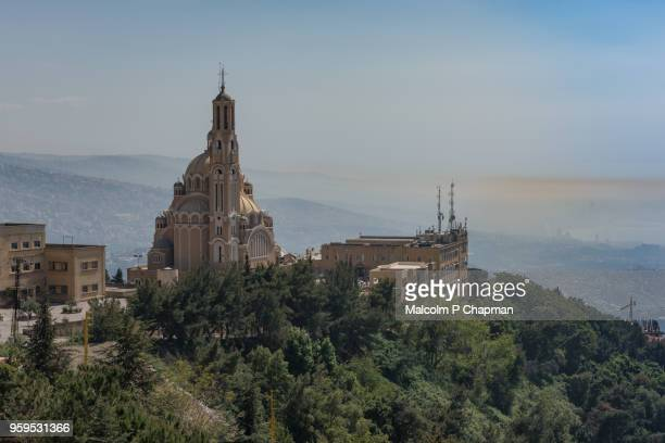 cathedral of st paul and view towards beirut (in haze) from harissa, jounieh, lebanon - beirut stock pictures, royalty-free photos & images