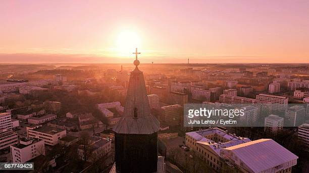 cathedral of turku in city against sky during sunset - turku finland stock photos and pictures