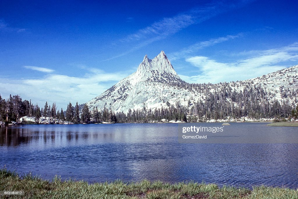Cathedral Peaksand Lake with Under Cloudy Sky : Stock Photo