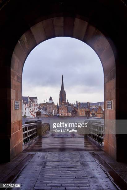 cathedral seen through arch against sky - arch stock pictures, royalty-free photos & images