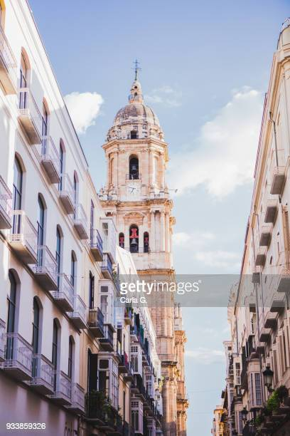 cathedral tower with blue sky, malaga, andalusia - málaga málaga province stock pictures, royalty-free photos & images