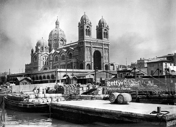 Cathedrale SainteMarieMajeure and the commercial port in front circa 1930 in Marseille France