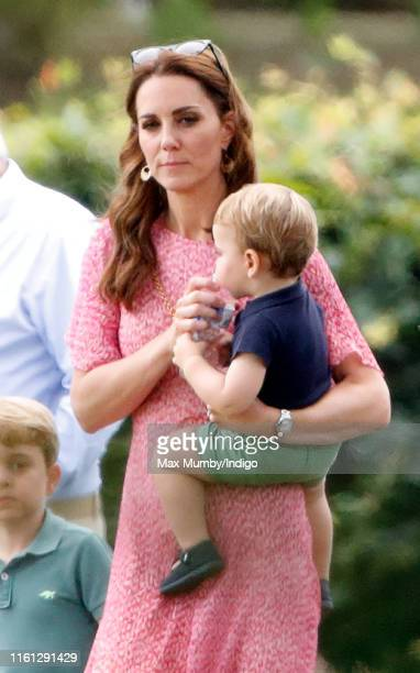 Catherine and Duchess of Cambridge and Prince Louis of Cambridge attend the King Power Royal Charity Polo Match in which Prince William Duke of...