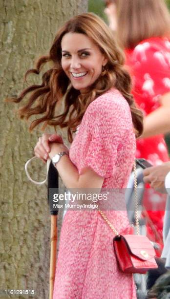 Catherine and Duchess of Cambridge attends the King Power Royal Charity Polo Match in which Prince William Duke of Cambridge and Prince Harry Duke of...