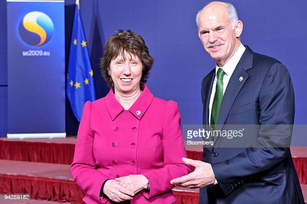 Catherine Ashton European Union foreign minister greets George Papandreou prime minister of Greece during a European Union leaders summit group photo...