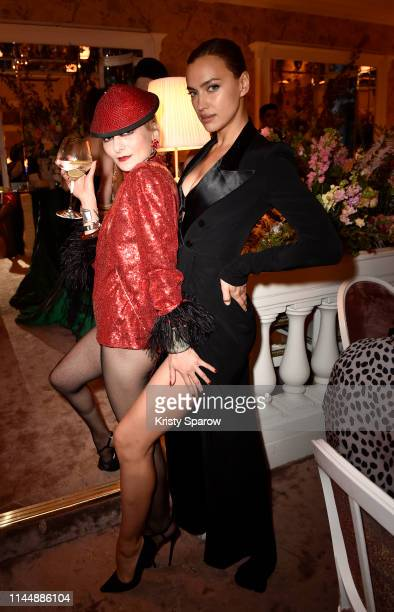 Catherine Baba and Irina Shayk attend the Scandal A Paris JeanPaul Gaultier's New Fragrance Launch Dinner Party at Lassere on April 24 2019 in Paris...