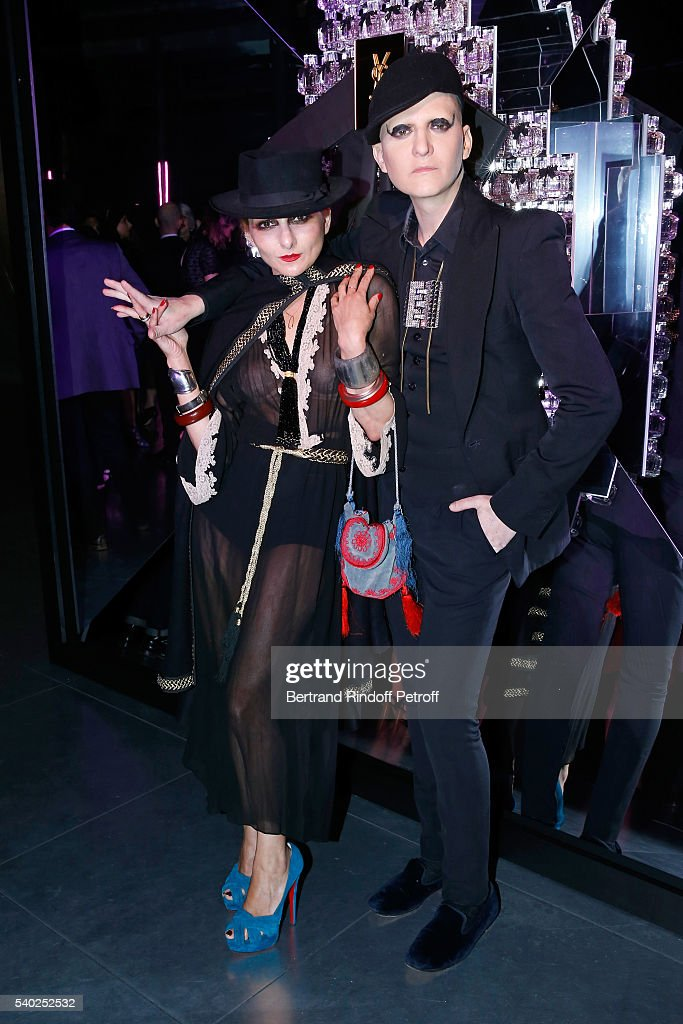 Catherine Baba and photographer Ali Mahdavi attend YSL Beauty launches the new Fragrance 'Mon Paris' at Cafe Le Georges on June 14, 2016 in Paris, France.
