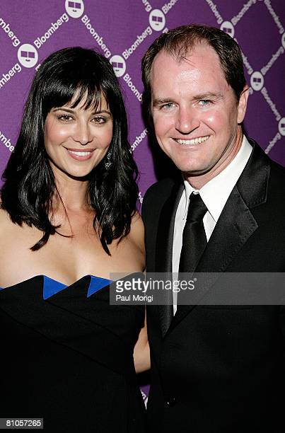 Catherine Bell and Adam Beason pose for a photo at the Bloomberg PreDinner Cocktail Reception at the Washington Hilton on April 26 2008 in Washington...