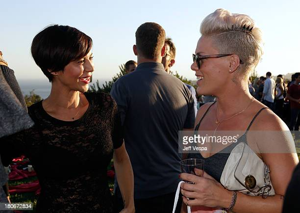 Catherine Bell and Pink attend Eddie Vedder and Zach Galifianakis Rock Malibu Fundraiser for EBMRF and Heal EB on September 15 2013 in Malibu...