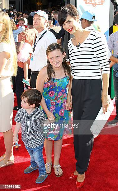 Catherine Bell Gemma Beason and Ronan Beason attend the Disney's Planes Los Angeles premiere held at the El Capitan Theatre on August 5 2013 in...