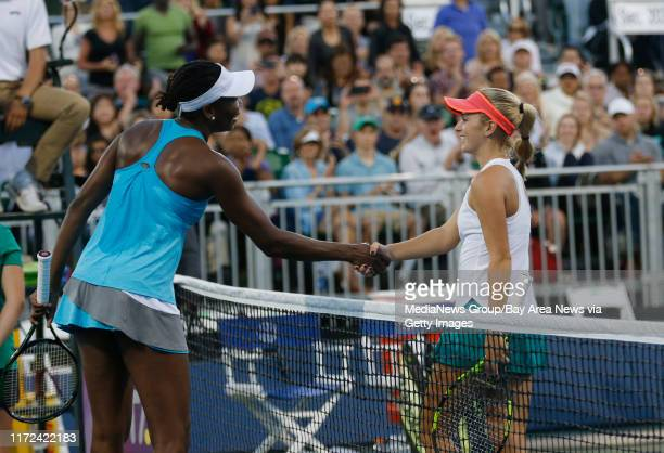 Catherine Bellis congratulates Venus Williams after Williams won their match during the quarterfinals of the Bank of the West Classic women's tennis...