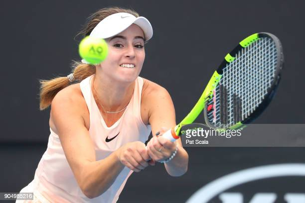 Catherine Bellis of the United States plays a backhand in her first round match against Kiki Bertens of the Netherlands on day one of the 2018...