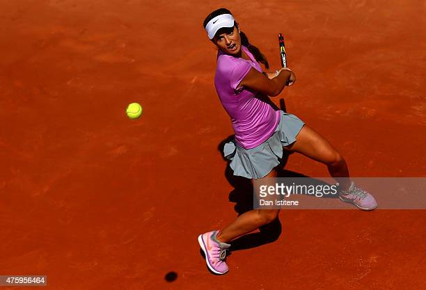 Catherine Bellis of the United States returns a shot during her girls' singles semi final match against Anna Kalinskaya of Russia on day thirteen of...