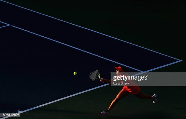 Catherine Bellis of the United States returns a shot to Petra Kvitova of the Czech Republic during their quarterfinal match on Day 5 of the Bank of...
