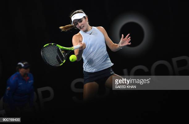 TOPSHOT Catherine Bellis of the US hits a return against Karolina Pliskova of the Czech Republic during their women's singles second round match at...