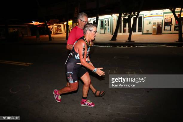 Catherine Beryl Wilson of Australia runs the final stretch before becoming the last finisher of the IRONMAN World Championship on October 14 2017 in...