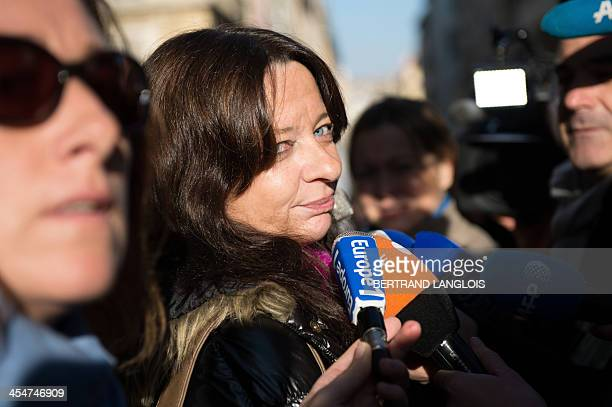 Catherine Bolognesi a French woman having breast implants made by Poly Implant Prostheses answers journalists' questions as she leaves the courthouse...