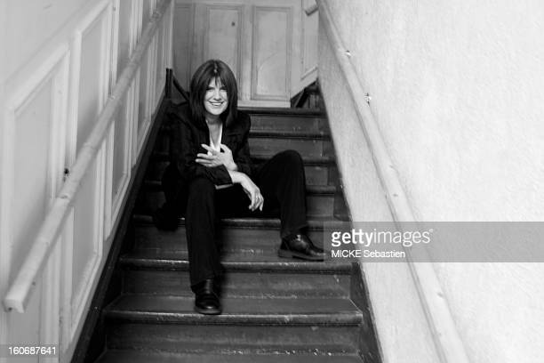 Catherine Breillat director of 'An old mistress' posed sitting in a staircase