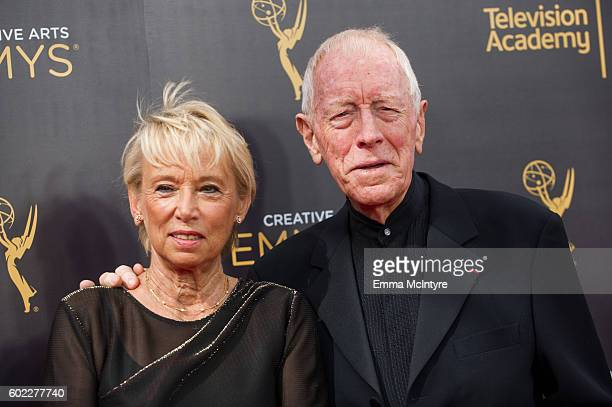 Catherine Brelet and Max von Sydow arrive at the Creative Arts Emmy Awards at Microsoft Theater on September 10 2016 in Los Angeles California