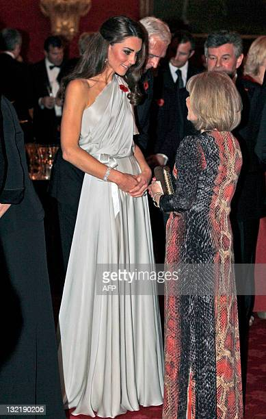 Catherine Britain's Duchess of Cambridge talks to people at a dinner reception in aid of the National Memorial Arboretum Appeal at St James's Palace...