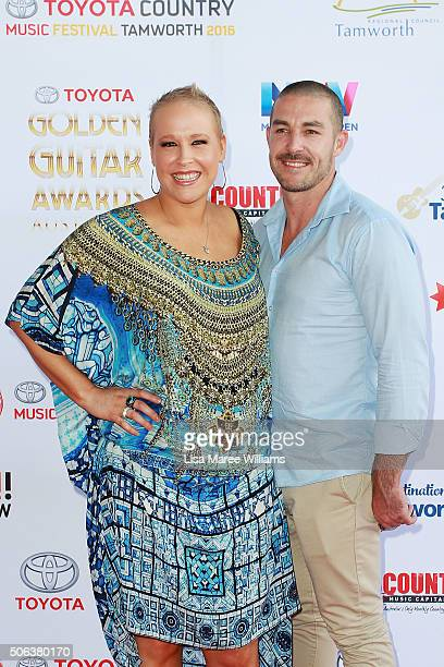 Catherine Britt and partner James Beverley arrive at the 44th Golden Guitar Awards on January 23 2016 in Tamworth Australia The Tamworth Country...