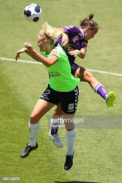Catherine Brown of Canberra and Caitlin Foord of the Glory contest for the ball during the WLeague Grand Final match between Perth and Canberra at...