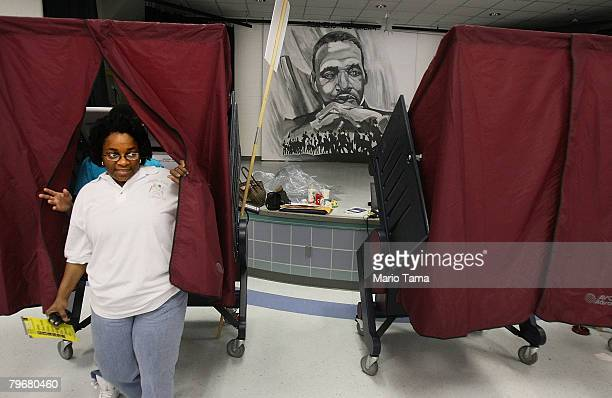 Catherine Brown whose family home in the Lower 9th Ward was destroyed by Hurricane Katrina exits a voting booth after casting her ballot at a polling...