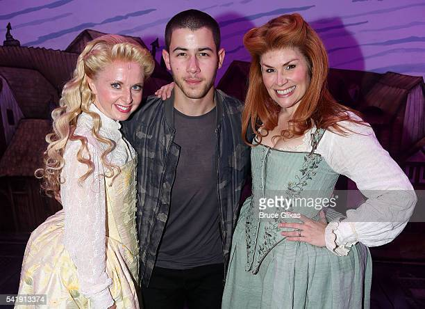 Catherine Brunell Nick Jonas and Heidi Blickenstaff pose backstage at the hit musical Something Rotten on Broadway at The StJames Theatre on June 20...
