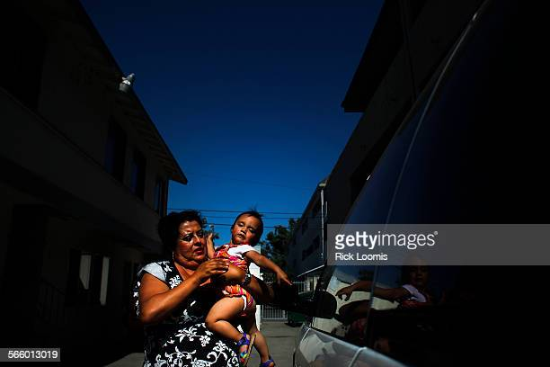 Catherine Carrasco lives in Santa Ana as a widow with her two daughters and one son in an area that has a high concentration of single parent...