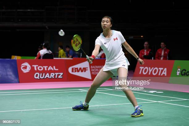 Catherine Choi of Canada competes against Sayaka Takahashi of Japan during Preliminary Round on day two of the BWF Thomas Uber Cup at Impact Arena on...