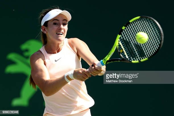 Catherine 'CiCi' Bellis returns a shot to Victoria Azarenka of Belarus during the Miami Open Presented by Itau at Crandon Park Tennis Center on March...