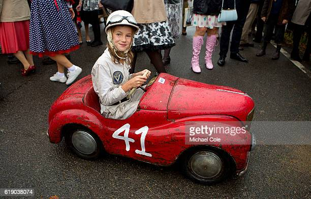 Catherine Collings winner of the Settrington Cup race on her way back to the paddock in the Austin J40 pedal car entered by Felicity Collings in the...