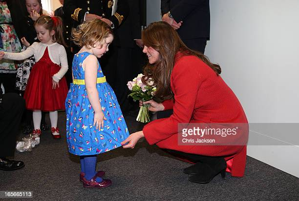 Catherine Countess of Strathearn helps Maizie Yeardley adjust her dress during a visit the Astuteclass Submarine Building at BAE Systems on April 5...