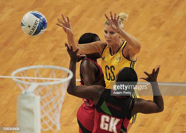 Catherine Cox of Australia passes the ball during the Group A Netball match betwen Australia and Malawi at Thyagaraj Sports Complex during day five...