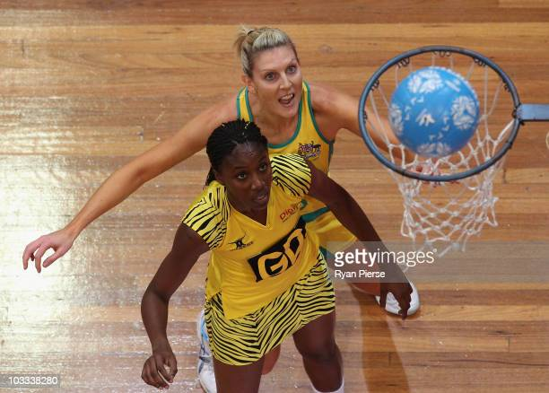 Catherine Cox of the Diamonds celebrates a goal as Georgia Gordon of Sunshine Girls looks on during game two of the Holden Netball Test series...