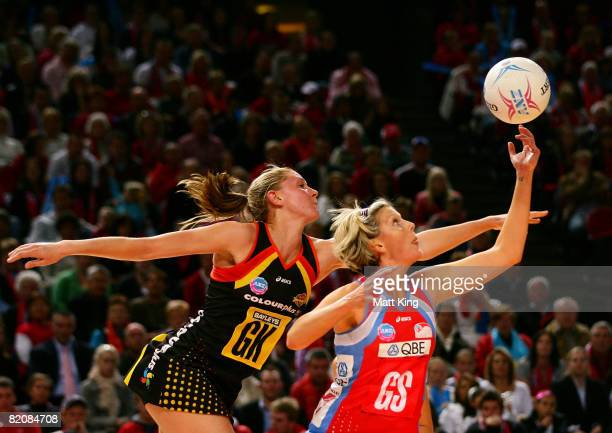 Catherine Cox of the Swifts and Casey Williams of the Magic jump for the ball during the ANZ Championships Grand Final match between the NSW Swifts...