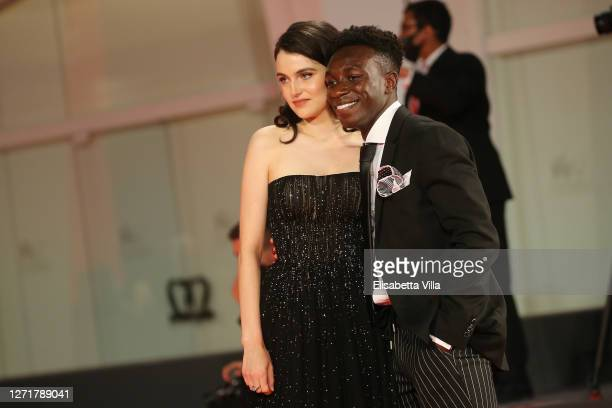 """Catherine Davis and Olly Sholotan walk the red carpet ahead of the movie """"Run Hide Fight"""" at the 77th Venice Film Festival on September 10, 2020 in..."""
