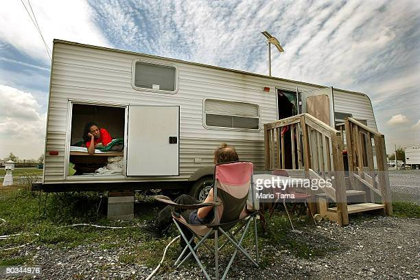 Catherine Dean sits on her makeshift bed in a FEMA trailer she shares with Harvey Tribe in the FEMA Diamond travel trailer park March 22, 2008 in...