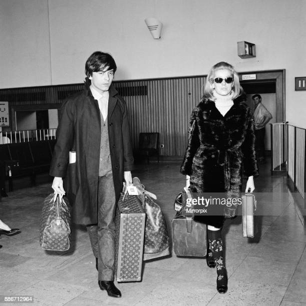 Catherine Deneuve actress and husband fashion photographer David Bailey arrive at London Airport from Paris She is here for the Royal performance of...