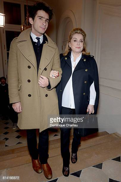 Catherine Deneuve and a guest attend the Saint Laurent show as part of the Paris Fashion Week Womenswear Fall/Winter 2016/2017 on March 7 2016 in...