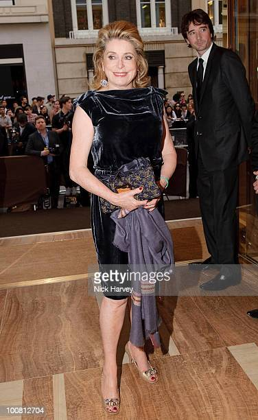 Catherine Deneuve and Antoine Arnault attend the launch of the Louis Vuitton Bond Street Maison on May 25 2010 in London England