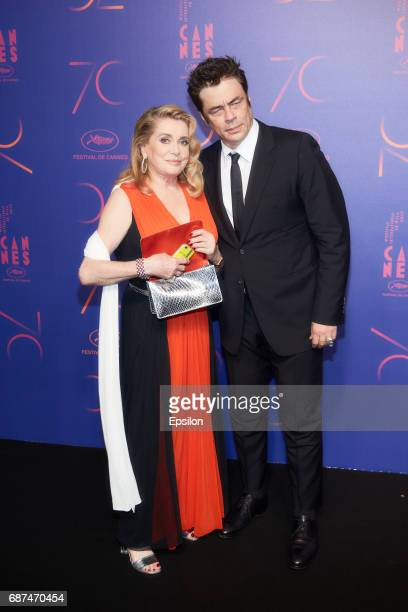 Catherine Deneuve and Benicio del Toro attend the 70th Anniversary Dinner during the 70th annual Cannes Film Festival at on May 23 2017 in Cannes...