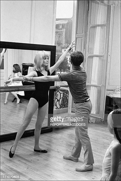 Catherine Deneuve and choreographer Norman Maen in shooting film ' Les Demoiselles de Rochefort' in Rochefort France on June 09 1966