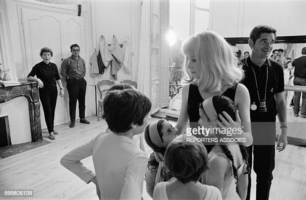 Catherine Deneuve And Director Jacques Demy On The Set Of The Movie 'Les Demoiselles De Rochefort' In Rochefort France On June 9 1966