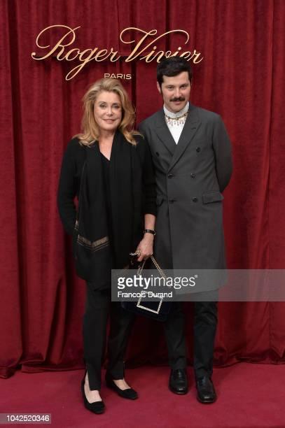 Catherine Deneuve and Gherardo Felloni attend the Roger Vivier Presentation Spring/Summer 2019 during Paris Fashion Week on September 27 2018 in...